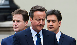© London News Pictures. 08/05/2015. NICK CLEGG, ED MILIBAND and DAVID CAMERON attend a VE day ceremony on Whitehall, London on the day David Cameron formed a majority government. Photo credit: Ben Cawthra/LNP