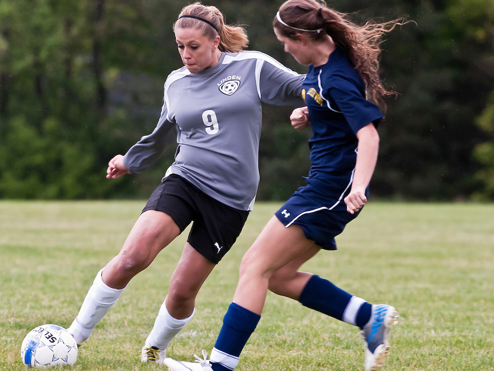 Lathan Goumas   MLive.com..May 9, 2012 - Kennedy Kunkel of Linden High School leaps dribbles the ball during a girls soccer game against Lapeer West High School at Linden High School in Argentine Township, Mich. on dow. Lapeer defeated Linden 1-0.