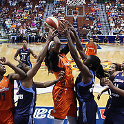 UNCASVILLE, CONNECTICUT- JUNE 3:   Jonquel Jones #35 of the Connecticut Sun is defended by Angel McCoughtry #35 of the Atlanta Dream and Elizabeth Williams #52 of the Atlanta Dream as she attempts to shoot during the Atlanta Dream Vs Connecticut Sun, WNBA regular season game at Mohegan Sun Arena on June 3, 2016 in Uncasville, Connecticut. (Photo by Tim Clayton/Corbis via Getty Images)