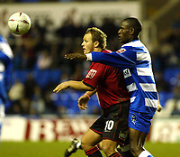 Fotball<br /> FA Cup England 2004/2005<br /> 3. runde<br /> 08.01.2005<br /> Foto: SBI/Digitalsport<br /> NORWAY ONLY<br /> <br /> Reading v Swansea<br /> <br /> Swansea's Lee Trundle and Reading's Ibrahima Sonko battle out the FA Cup tie at the Madejski stadium.
