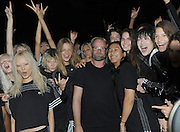 Designer Alexander Wang, center right, and Adidas creative director Nic Galway, center left, pose with models after the 'Adidas Originals by Alexander Wang' collection is shown at Fashion Week in New York, Saturday, Sept. 10, 2016.  (AP Photo/Diane Bondareff)