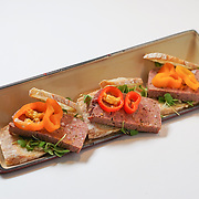 Lamb Jam Seattle Mediterranean contestant: Red Cow, Chef Thom Koschwanez (lamb terrine sandwich with smoked eggplant puree and pickled sweet peppers).
