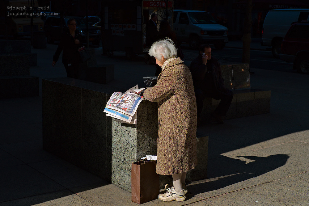 Woman witih tabloid newspaper