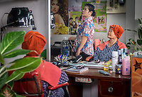 MAE KLONG - TAHILAND - CIRCA SEPTEMBER 2014: Thai women in a hair salon around the Maeklong Railway Market