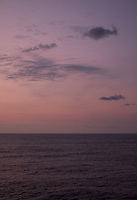 Pastel colored sky and clouds over the Pacific Ocean at dawn.  Image 16 of 21  for a panorama taken with a Fuji X-T1 camera and 35 mm f/1.4 lens  (ISO 400, 35 mm, f/2.8, 1/30 sec). Raw images processed with Capture One Pro and stitched together with AutoPano Giga Pro.