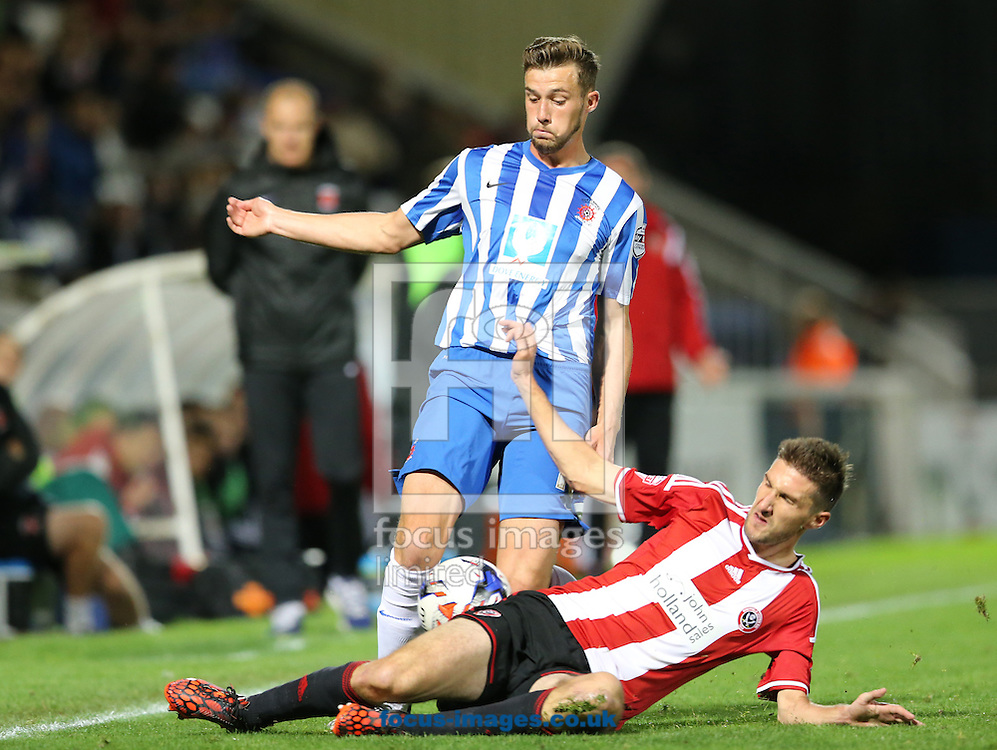 Lewis Hawkins of Hartlepool United getting tackled by Chris Basham of Sheffield United during the Johnstone's Paint Trophy match at Victoria Park, Hartlepool<br /> Picture by Simon Moore/Focus Images Ltd 07807 671782<br /> 07/10/2014