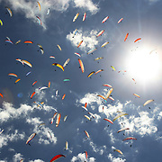 149 of the World's best paragliding pilots from 39 nations descended on the small country town of Manilla near Tamworth in northern New South Wales, Australia to contest the 10th FAI Paragliding World Championships during March 2007. The drought stricken area is renowned for it's great cross country flying from the Mount Borah hillside and over two hectic weeks, numerous incidents and mixed weather, the pilots were able to fly five tasks to decide the winners in what proved to be an extremely close contest.. The Men's competition was won by Great British pilot Bruce Goldsmith with Jean-Marc Caron of France finishing second just seventeen points behind with Thomas Mccune of USA finishing third. The women's competition was won by Petra Slivova of Czech Republic with Viv Williams of Australian just fifteen points behind and New Zealand pilot Harmony Gaw finishing third. .In the team event Czech Republic finished first followed by France and Switzerland....Pilots take to the skies during competition where they form gaggle's and look for the best lift from thermal's..