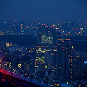 Looking out at the wider Tokyo skyline at night from the top of Roppongi...a symphony of red lights