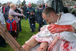 Crowds at Morley watch the Infantry Regiment 276, field Hospital Display as a surgeon operates on a battlefield casualty <br />