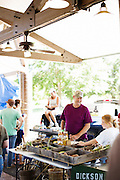 HOT SPRINGS, AR – JUNE 29, 2013: Al Dickson (left) stands with his daughter sell produce each week at the local farmer's market.