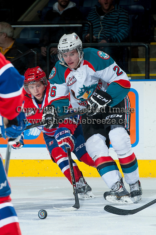 KELOWNA, CANADA -JANUARY 29: Cole Linaker #26 of the Kelowna Rockets moves the puck on the ice against the Spokane Chiefs on January 29, 2014 at Prospera Place in Kelowna, British Columbia, Canada.   (Photo by Marissa Baecker/Getty Images)  *** Local Caption *** Cole Linaker;