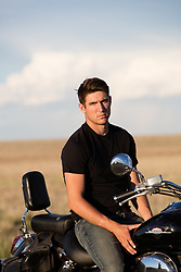 hot man sitting on a motorcycle
