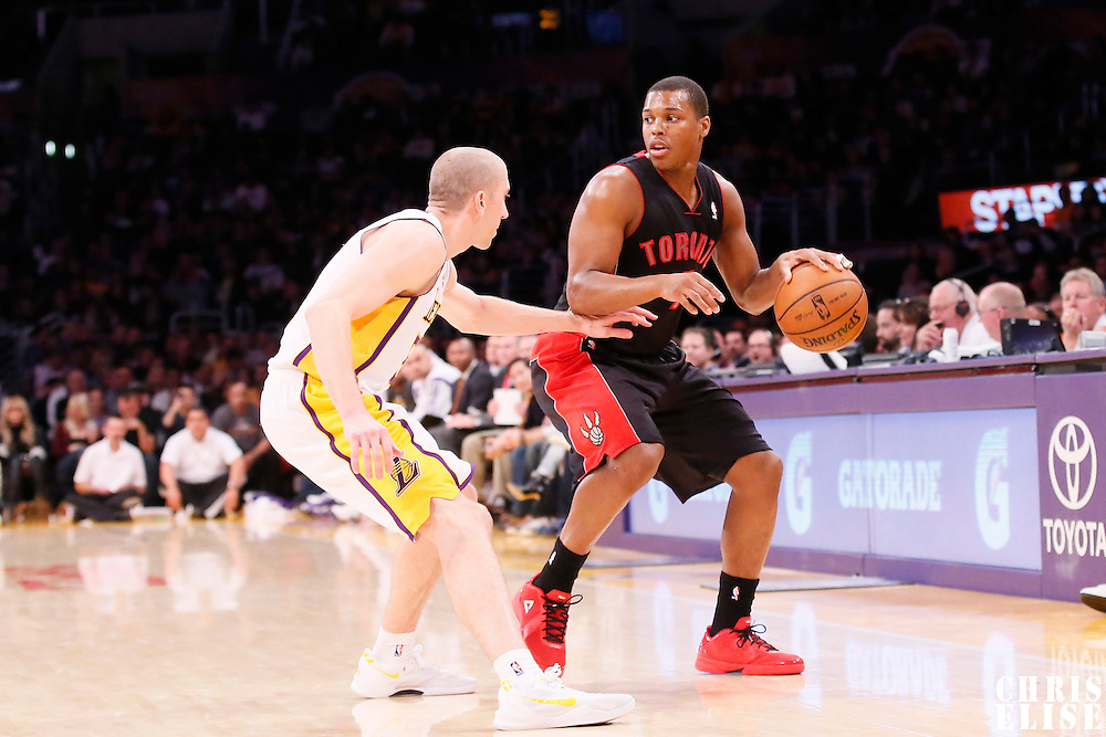 08 December 2013: Los Angeles Lakers point guard Steve Blake (5) defends on Toronto Raptors point guard Kyle Lowry (7) during the Toronto Raptors 106-94 victory over the Los Angeles Lakers at the Staples Center, Los Angeles, California, USA.