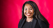 Expressive,smiling portait of female divorce attorney on red background with negative space and gradient.