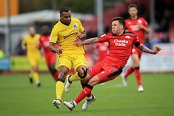 Jimmy Smith of Crawley Town clears the ball as he's tackled by Jermaine Easter of Bristol Rovers - Mandatory by-line: Jason Brown/JMP - 05/11/2016 - FOOTBALL - Checkatrade.com Stadium - Crawley, England - Crawley Town v Bristol Rovers - Emirates FA Cup first round