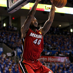Jun 12, 2012; Oklahoma City, OK, USA; Miami Heat power forward Udonis Haslem (40) dunks against the Oklahoma City Thunder during the first quarter of game one in the 2012 NBA Finals at the Chesapeake Energy Arena.  Mandatory Credit: Derick E. Hingle-US PRESSWIRE