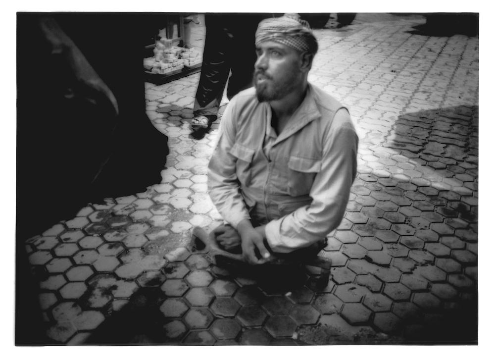 Man who lost is legs and one eye in war begs on Kabul sidewalk, Afghanistan.