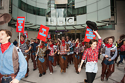Cowboys For Country Music, Line Dance in protest against BBC Radio 1 not playing country music, outside BBC Broadcasting House today, London, United Kingdom. Tuesday, 10th September 2013. Picture by i-Images