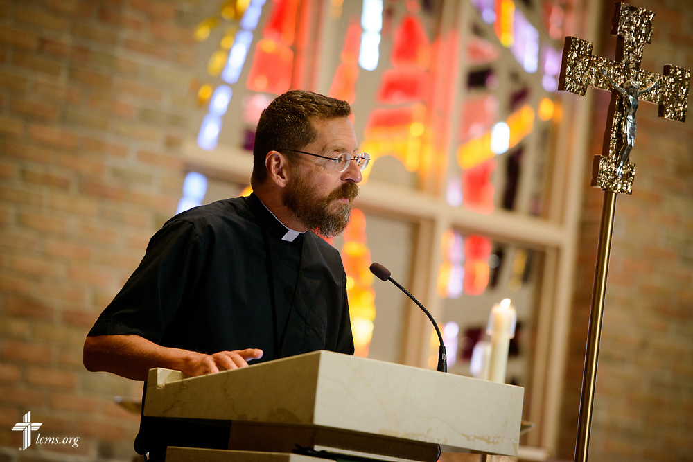 The Rev. William Weedon, director of LCMS worship, greets attendees at the 2017 Institute on Liturgy, Preaching and Church Music on Wednesday, July 26, 2017, at Concordia University Chicago in River Forest, Ill. LCMS Communications/Erik M. Lunsford