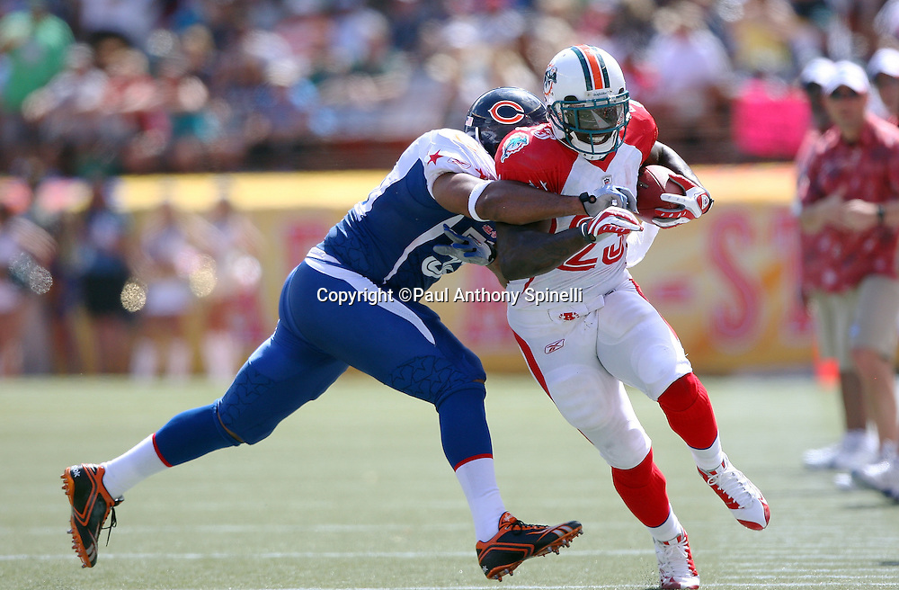 HONOLULU, HI - FEBRUARY 08: AFC All-Stars running back Ronnie Brown #23 of the Miami Dolphins runs the ball while trying to avoid a tackle by linebacker Lance Briggs #55 of the Chicago Bears of the NFC All-Stars in the 2009 NFL Pro Bowl at Aloha Stadium on February 8, 2009 in Honolulu, Hawaii. The NFC defeated the AFC 30-21. ©Paul Anthony Spinelli *** Local Caption *** Ronnie Brown;Lance Briggs
