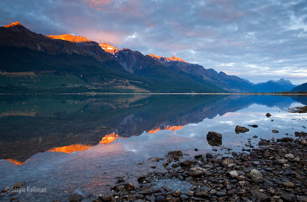 Early AM sun hits the  high peaks of the Southern Alps above Lake Wakatipu near Glenorchy in New Zealand's South Island.