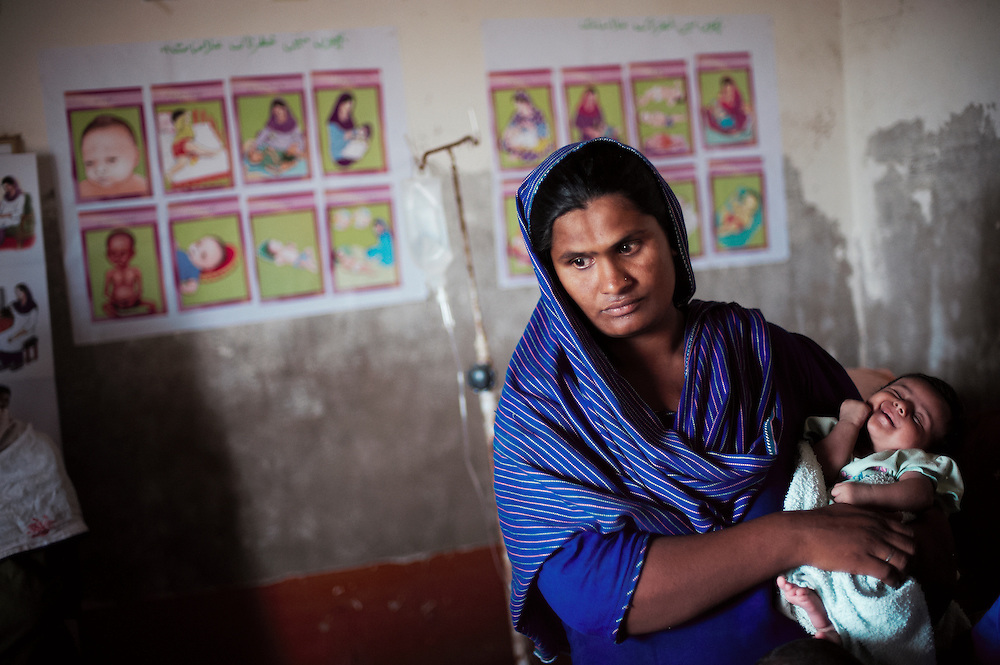 Najma Shafi, 30 years old visits the  government health clinic in the village of Sheer Ali Shah, Thatta, Sindh, Pakistan on July 1, 2011. Baby Rashida is 1 month old. Najma has seven children.