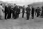 President John F. Kennedy arrives at Dublin Airport. He is greeted by President Eamon de Valera as he steps fom the plane.  An Taoiseach Seán Lemass waits to greet him.<br /> 26.06.1963