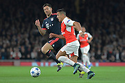 Arsenal striker Alexis Sanchez attacks watched by Bayern Munich midfielder Xabi Alonso during the Champions League  Group F match between Arsenal and Bayern Munich at the Emirates Stadium, London, England on 20 October 2015. Photo by Alan Franklin.