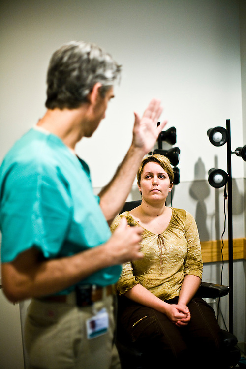 Alisha Bacoccini speaks with Dr. Albert Maguire, after being tested on her ability to detect color, at UPenn Hospital, in Philadelphia, PA on Monday, June 23, 2008. Bacoccini is undergoing an experimental gene therapy trial to improve her sight.