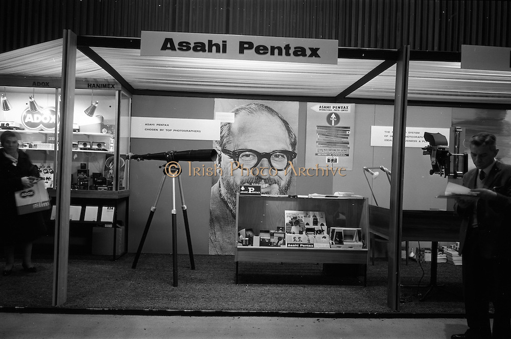 09/04/1964<br /> 04/09/1964<br /> 09 April 1964<br /> Photographic equipent company stands at the Photography Fair at the Intercontinental Hotel, Dublin. The Asahi Pentax stand.