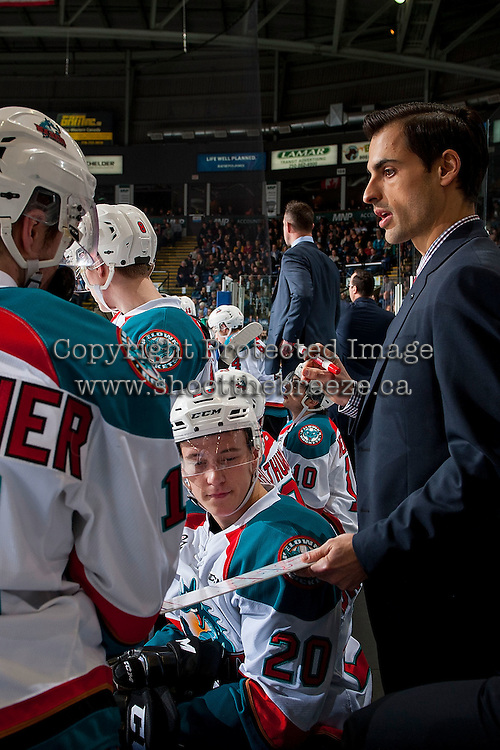 KELOWNA, CANADA - MARCH 4: Assistant coach Travis Crickard goes over a play on the bench with Conner Bruggen-Cate #20 of the Kelowna Rockets against the Tri-City Americans on March 4, 2017 at Prospera Place in Kelowna, British Columbia, Canada.  (Photo by Marissa Baecker/Shoot the Breeze)  *** Local Caption ***