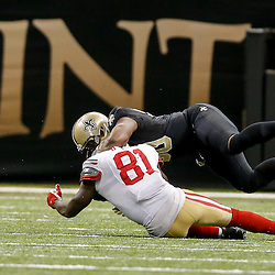 Nov 9, 2014; New Orleans, LA, USA; New Orleans Saints middle linebacker Curtis Lofton (50) breaks up a pass to San Francisco 49ers wide receiver Anquan Boldin (81) during the fourth quarter of a game at Mercedes-Benz Superdome. The 49ers defeated the Saints 27-24 in overtime. Mandatory Credit: Derick E. Hingle-USA TODAY Sports