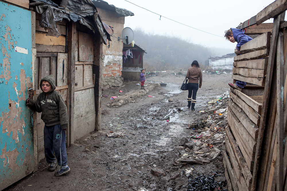 """Road in the middle of the Roma settlement located in """"Budulovskej Street"""" in Moldava nad Bodvou, Eastern Slovakia about 30 km from Kosice."""