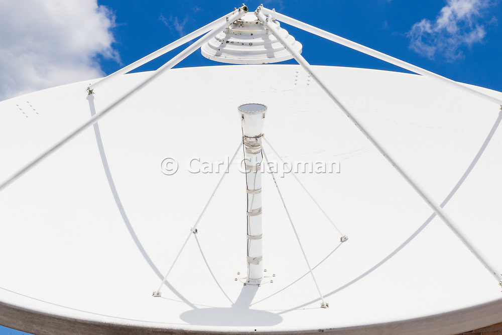 Satellite dish antenna and feed horn at remote communications site at Mount Canobolas, News South Wales, Australia