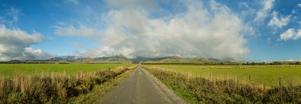 Panoramic of a rainbow at the foothills of the Takitimu Mountains, Southland, New Zealand