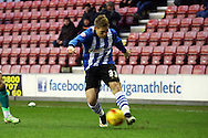 Martyn Waghorn of Wigan Athletic looks to cross the ball. Skybet football league championship match , Wigan Athletic v Blackburn Rovers at the DW Stadium in Wigan, Lancs on Saturday 17th Jan 2015.<br /> pic by Chris Stading, Andrew Orchard sports photography.