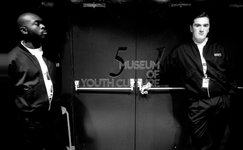 Two members of security stand by the main Fac 51 doors to the Hacienda, Manchester, early 1990's