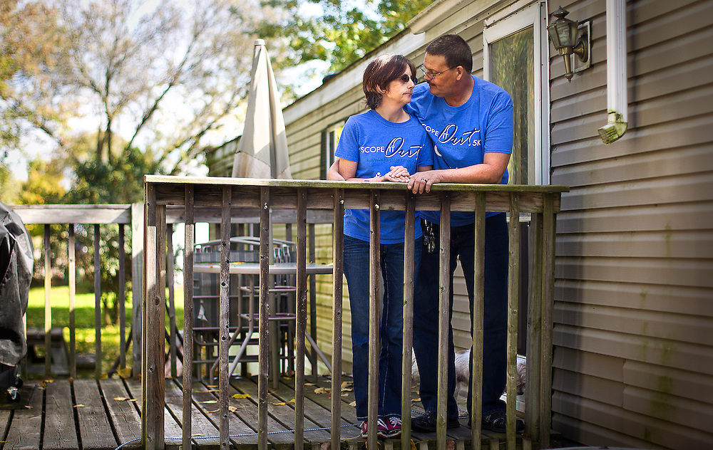 NORTH FREEDOM — October 6, 2014: SaDonna Oakley, left, stands with her husband, Joe, in their North Freedom trailer park home. Oakley was diagnosed with Stage IV colon cancer in May 2014 and went into surgery early morning on Tuesday, October 7 at St Mary's Hospital in Madison.