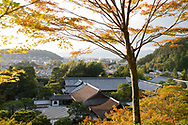 An aerial view through acer foliage over the temple complex at the Ginkaku-ji Pure Land Garden. Kyoto, Japan