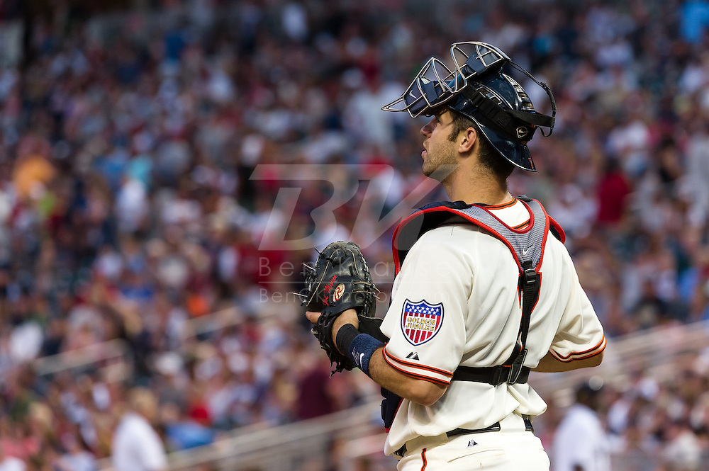 Wearing the 1951 uniform of the Minneapolis Millers,  Minnesota Twins catcher Joe Mauer looks during a game against the Kansas City Royals at Target Field on June 30, 2012 in Minneapolis, Minnesota.  This was the second game of a split double header.  The Twins defeated the Royals 5 to 1. © 2012 Ben Krause