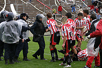 11/09/05 - Mendoza - Argentina - <br />Carlos Azcurra, (IN THE FLOOR) of the Mendoza club San Martin, Argentina's second-division team, is shooting by a police officer with a rubber bullet, after argue with them. Sunday, Sept. 11, 2005 in Mendoza, some 650 miles west of Buenos Aires. <br />© Argenpress.com / Piko-Press