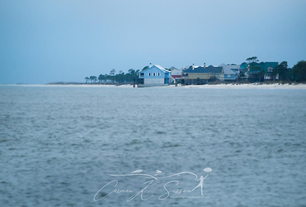 Beach houses line the shoreline on Dauphin Island, Alabama. (Photo by Carmen K. Sisson/Cloudybright)