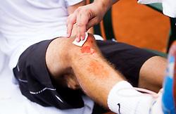 Injured Janez Semrajc of Slovenia after winning during Davis Cup Slovenia vs. South Africa on September 15, 2013 in Tivoli park, Ljubljana, Slovenia. (Photo by Vid Ponikvar / Sportida.com)