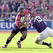Photo Peter Spurrier.12/10/2002.Heineken European Cup Rugby.Gloucester vs Munster - Kingsholm.Gloucester's Marcel Garvey breaking through Mike Mullins tackle.