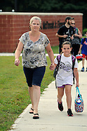 WARMINSTER, PA - SEPTEMBER 3: Mary McQuaud walks with her daughter Amber McQuade, 9 as they arrive for the first day of school September 3, 2013 at the new McDonald Elementary School in Warminster, Pennsylvania. (Photo by William Thomas Cain/Freelance)