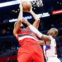 12 December 2016: Portland Trail Blazers guard Allen Crabbe (23) is fouled by LA Clippers guard Chris Paul (3) during the LA Clippers 121-120 victory over the Portland Trail Blazers, at the Staples Center, Los Angeles, California, USA.