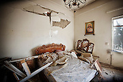 March 17 , 2012 , Damascus Syria : destroyed bedroom in a house in Kassa'a neighborhood due a explosion of a suicide car bomb targeted the neighborhood that day and left tens of victims between dead and injured .