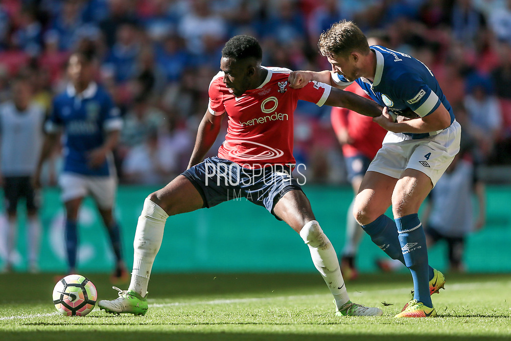 Amari Morgan-Smith (York City) holds off Neill Byrne (Macclesfield Town) during the FA Trophy match between Macclesfield Town and York City at Wembley Stadium, London, England on 21 May 2017. Photo by Mark P Doherty.