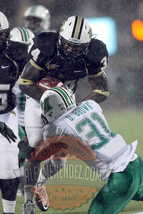 Marshall safety Omar Brown (31) tackles Central Florida running back Brynn Harvey (34) during an NCAA football game between the Marshall Thundering Herd and the Central Florida Knights at Bright House Networks Stadium on Saturday, October 8, 2011 in Orlando, Florida. (Photo/Alex Menendez)