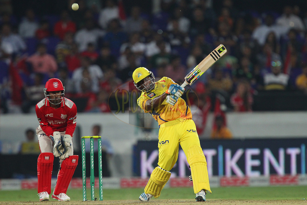 Dwayne BRAVO of the Chennai Superkings hits out and is caught by Glenn MAXWELL of the Kings XI Punjab  during the second semi final match of the Oppo Champions League Twenty20 between the Kings XI Punjab and the Chennai Superkings held at the Rajiv Gandhi Cricket Stadium, Hyderabad, India on the 2nd October 2014<br /> <br /> Photo by:  Ron Gaunt / Sportzpics/ CLT20<br /> <br /> <br /> Image use is subject to the terms and conditions as laid out by the BCCI/ CLT20.  The terms and conditions can be downloaded here:<br /> <br /> http://sportzpics.photoshelter.com/gallery/CLT20-Image-Terms-and-Conditions-2014/G0000IfNJn535VPU/C0000QhhKadWcjYs